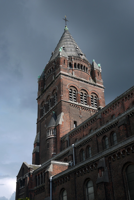 Antwerp, church and cloudy sky