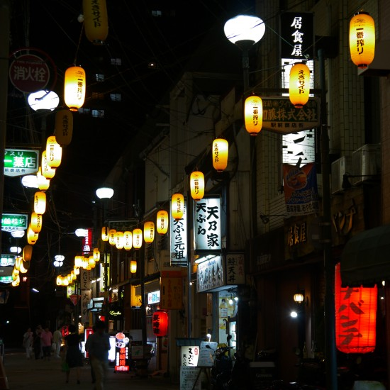 Nagasaki, street at night with lanterns near train station